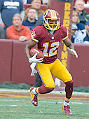 Washington Redskins kick-off returner Andre Roberts (12) returns a first quarter kick-off in first quarter action against the Dallas Cowboys at FedEx Field in Landover, Maryland on Sunday, December 28, 2014.  <br /> Credit: Ron Sachs / CNP