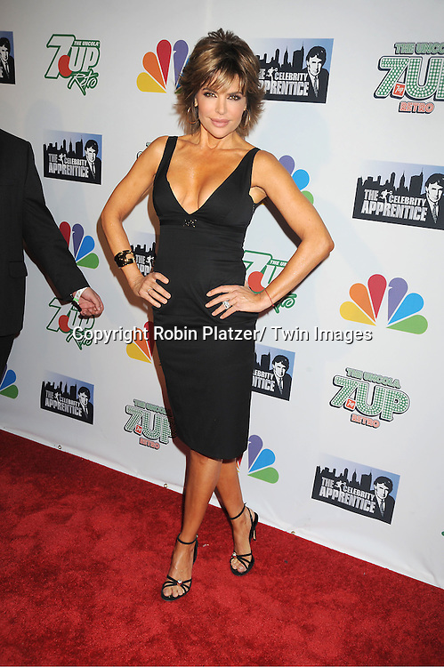 """Lisa Rinna in black Gucci dress posing for photographers at """"The Celebrity Apprentice"""".Season Four Finale Party on May 22, 2011 at The Trump Soho Hotel in New York City."""