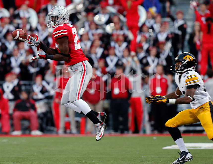 Ohio State Buckeyes defensive back Tyvis Powell (23) intercepts a pass intended for Iowa Hawkeyes wide receiver Damond Powell (22) in the fourth quarter of their game at Ohio Stadium in Columbus, Ohio on October 19, 2013. Columbus Dispatch photo by Brooke LaValley)