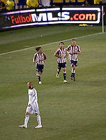 Chivas USA teammates midfielder Francisco Mendoza (6-L) forwards Ante Razov (9-C) and Justin Braun (17-R) after scoring a goal as LA Galaxy midfielder David Beckham (23) looks on during the Super Clasico MLS match. The LA Galaxy defeated Chivas USA 5-2 during the SuperClasico at the Home Depot Center Stadium, in Carson, California, Saturday, April 26, 2008.