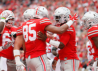 Ohio State Buckeyes quarterback J.T. Barrett (16) celebrates a 16-yard touchdown catch with tight end Marcus Baugh (85) during the first half of the NCAA football game at Ohio Stadium in Columbus on Oct. 1, 2016. (Adam Cairns / The Columbus Dispatch)