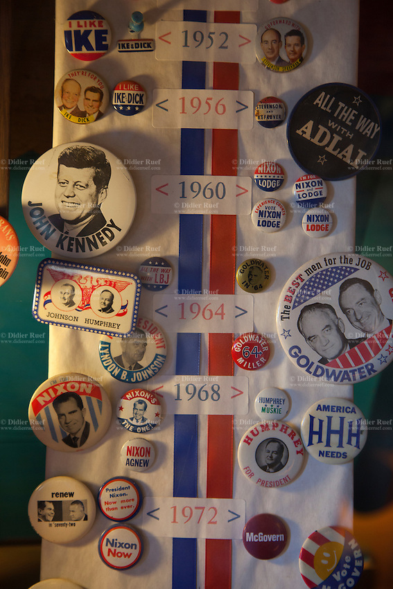 """USA. Arizona state. Superior town. World's Smallest Museum. Artifacts of Ordinary Life. Winners and losers canditates' campaign buttons for President of the United States. Dwight David """"Ike"""" Eisenhower. John Fitzgerald Kennedy. Lyndon Baines Johnson. Richard Milhous Nixon. A campaign button is a pin used during an election as political advertising for a candidate or political party, or to proclaim the issues that are part of the political platform. Political buttons date as far back as President George Washington. They have taken many forms as the technology to create an image and mass production has allowed. In the late 18th and first half of the 19th century they were sewn-on clothing buttons, whereas the modern forms typically have pins on the back and are therefore also called pin-back buttons. As a novelty item, campaign buttons are part of the hobby of collecting. 29.01.16 © 2016 Didier Ruef"""
