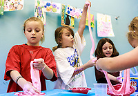 NWA Democrat-Gazette/CHARLIE KAIJO (From left) Libby White, 8, Bentonville, Karina Coello, 8, of Bentonville and Lily Goodner, 8, of Bentonville plays with slime they made during a summer art workshop, Thursday, July 5, 2018 at Imagine Studios in Rogers. <br /><br />Imagine Studios will host nine weeks of summer art camps and workshops, each with different themes. Activities include canvas painting, pottery painting, slime making and water color painting.