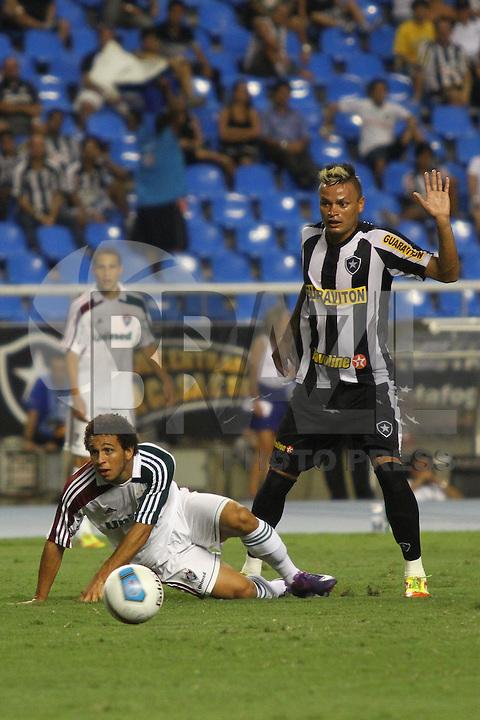 RIO DE JANEIRO, RJ, 23 DE FEVEREIRO 2012 - CAMPEONATO CARIOCA - SEMIFINAL - TAÇA GUANABARA - BOTAFOGO X FLUMINENSE - Wellington Nem, jogador do Fluminense, sofre falta de Fábio Ferreira, durante partida contra o Botafogo, pela semifinal da Taça Guanabara, no estádio Engenhão, na cidade do Rio de Janeiro, nesta quinta-feira, 23. FOTO: BRUNO TURANO – BRAZIL PHOTO PRESS