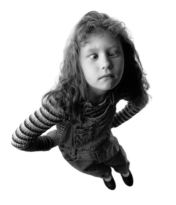 Black & White image of young girl crossing her eyes; they may get stuck!.