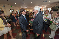 Photo from the ribbon cutting and grand opening of the Green Bean Coffee Lounge, Oxy's student-run café off of Branca Batio in the Johnson Student Center during Homecoming Weekend, Oct. 23, 2009. Present were Oxy presidents Robert Skotheim and Jonathan Veitch, Steve Green '87 and Oxy students Gregory Benz (Sales Analysis), Christian Hernandez (Inventory and Finance), Raquel Carrion (Staffing), Evelyn Renoa Batista (Programming and Customer Service), among others.<br /> (Photo by Marc Campos, Occidental College Photographer)