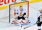 11 November 2008:  Ottawa Senators' goaltender Alex Auld makes a save against Montreal Canadiens in the third period at the Bell Centre in Montreal, Quebec, Canada. The Canadiens, celebrating their 100th season, defeated the visiting Senators 4-0. ***Editorial Sales Only***..Mandatory Photo Credit: Ed Wolfstein Photo *** Editorial Sales through Icon Sports Media *** www.iconsportsmedia.com
