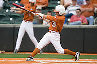 Texas OF Mark Payton (15) follows through against Stanford on March 4th, 2011 at UFCU Disch-Falk Field in Austin, Texas.  (Photo by Andrew Woolley / Four Seam Images)