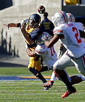 Ohio State Buckeyes linebacker Ryan Shazier (10) knocks the ball away from California Golden Bears quarterback Jared Goff (16) for a fumble that the Buckeyes recovered in the 1st quarter at Memorial Stadium in Berkeley, California on September 14, 2013.  (Dispatch photo by Kyle Robertson)