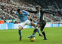 30th November 2019; St James Park, Newcastle, Tyne and Wear, England; English Premier League Football, Newcastle United versus Manchester City; Allan Saint-Maximin of Newcastle United tackles Gabriel Jesus of Manchester City  - Strictly Editorial Use Only. No use with unauthorized audio, video, data, fixture lists, club/league logos or 'live' services. Online in-match use limited to 120 images, no video emulation. No use in betting, games or single club/league/player publications