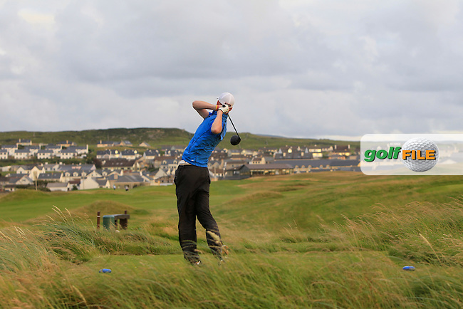 Evan Farrell (Ardee) on the 18th tee during Round 1 of the South of Ireland Amateur Open Championship at LaHinch Golf Club on Wednesday 22nd July 2015.<br /> Picture:  Golffile | Thos Caffrey