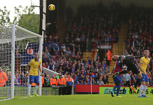 26.10.2013 London, England. Wojciech Szczesny tips a goalbound shot over the bar during the Premier League game between Crystal Palace and Arsenal from Selhurst Park.