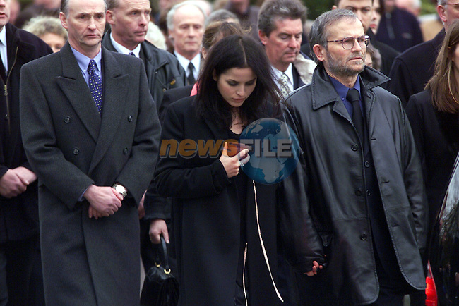 Andrea Corr holds the hand of her father Gerry as she fights back tears as they walks  behind the Coffin of Mother Gean in Dundalk on Saturday..Pic Newsfile.BYLINE PLEASE