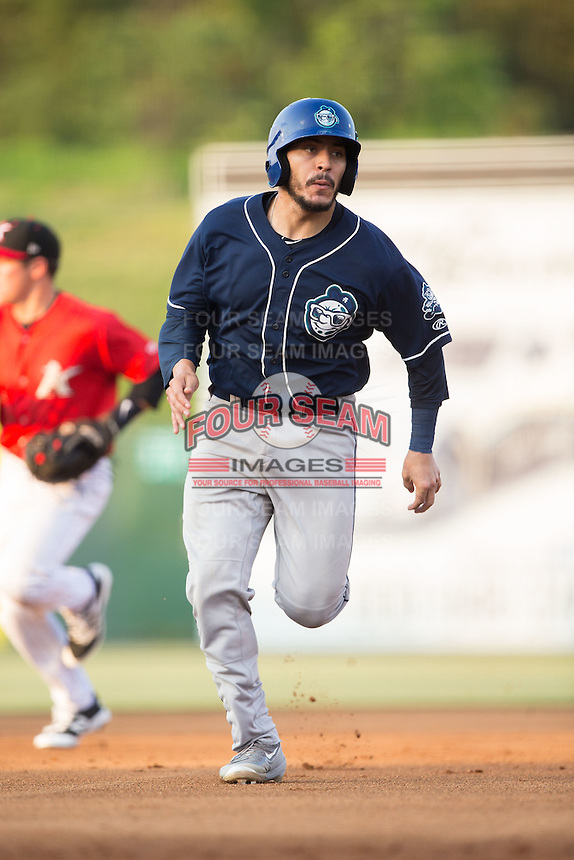 Chris Rabago (22) of the Asheville Tourists hustles towards third base against the Kannapolis Intimidators at Kannapolis Intimidators Stadium on May 26, 2016 in Kannapolis, North Carolina.  The Tourists defeated the Intimidators 9-6 in 11 innings.  (Brian Westerholt/Four Seam Images)