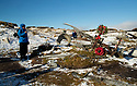 09/11/19<br /> <br /> A prayer is said before two minute silence.<br /> <br /> Surrounded by fresh overnight snow, hikers gather, in one of the remotest areas of the Derbyshire Peak District, for a two minute silence and to lay wreaths and crosses on the wreckage of an American RB29 bomber, known  as 'Over-Exposed' which crashed on Bleaklow Moor near Higher Shelf Stones, killing all thirteen crew in November 1948. Piles of twisted metal have been piled up to form a makeshift memorial that lies next to whole engines, pieces of fuselage, wings, wheels and other twisted parts of aluminium that have lain on the moors for  71 years.<br /> <br /> Today prayers were said, a harmonica player performed the Last Post and Taps (the US equivalent) and members of the Woodhead Mountain Rescue teams remembered their forbears who were first to arrive at the crash scene after the bomber descended in low cloud hitting the high peak.<br /> <br /> All Rights Reserved: F Stop Press Ltd.  <br /> +44 (0)7765 242650 www.fstoppress.com