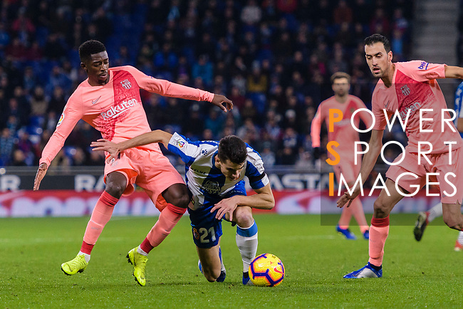 Ousmane Dembele of FC Barcelona (L) fights for the ball with Marc Roca of RCD Espanyol (C) during the La Liga 2018-19 match between RDC Espanyol and FC Barcelona at Camp Nou on 08 December 2018 in Barcelona, Spain. Photo by Vicens Gimenez / Power Sport Images