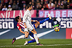 Cristiano Ronaldo of Real Madrid battles for the ball with Stefan Savic of Atletico de Madrid during their La Liga match between Atletico de Madrid and Real Madrid at the Vicente Calderón Stadium on 19 November 2016 in Madrid, Spain. Photo by Diego Gonzalez Souto / Power Sport Images