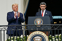 "Sheikh Abdullah bin Zayed bin Sultan Al Nahyan, Minister of Foreign Affairs and International Cooperation of the United Arab Emirates makes remarks as United States President Donald J. Trump and First lady Melania Trump host a signing ceremony of the ""Abraham Accords"" on the South Lawn of the White House in Washington, DC on Tuesday, September 15, 2020.  The Trumps are joined by Prime Minister Benjamin Netanyahu of Israel; Sheikh Abdullah bin Zayed bin Sultan Al Nahyan, Minister of Foreign Affairs and International Cooperation of the United Arab Emirates; and Dr. Abdullatif bin Rashid Alzayani, Minister of Foreign Affairs, Kingdom of Bahrain.<br /> Credit: Chris Kleponis / Pool via CNP /MediaPunch"