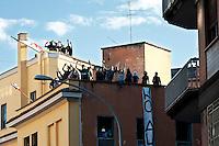Roma 5 Aprile 2010.Occupata da CasaPound Italia la scuola 'Parinì di Montesacro abbandonata da tre anni per dare alloggi a 17 famiglie in stato di gravissima emergenza abitativa. Gli occupanti  rispondono agli slogan degli antifascisti che protestano contro l'occupazione.Rome April 5, 2010.Occupied by CasaPound Italy, the school 'Parini Montesacro abandoned by three years, to give housing to 17 families in serious housing crisis..