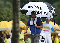 Brolly up for Andy Sullivan (ENG) as the rain suspends play during the Final Round of the 2014 Maybank Malaysian Open at the Kuala Lumpur Golf & Country Club, Kuala Lumpur, Malaysia. Picture:  David Lloyd / www.golffile.ie