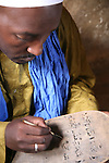 The marabout is writing coranic versets on a wooden boards. Every verset is then learned by heart by his pupils. The coranic schools in Timbuctu are only open early in the morning and on Saturdays in order to allow pupils to attend the public school.