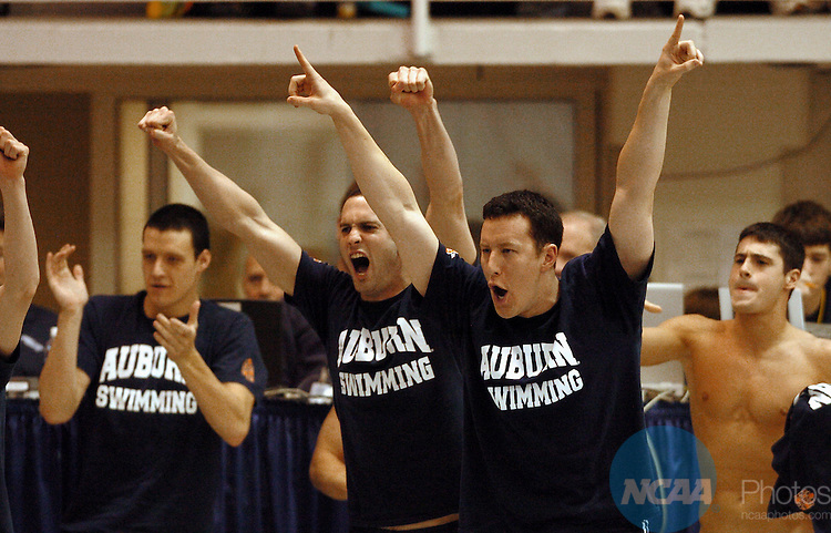 25 MARCH 2006: Members of the Auburn University swim team celebrate diver Steven Segerlin's win in the platform diving event during the 2006 Division 1 Men's Swimming and Diving Championship at the Georgia Tech Aquatic Center at Georgia Tech in Atlanta, Ga. Auburn won the team championship with a score of 480.5 Erik S. Lesser/NCAA Photos