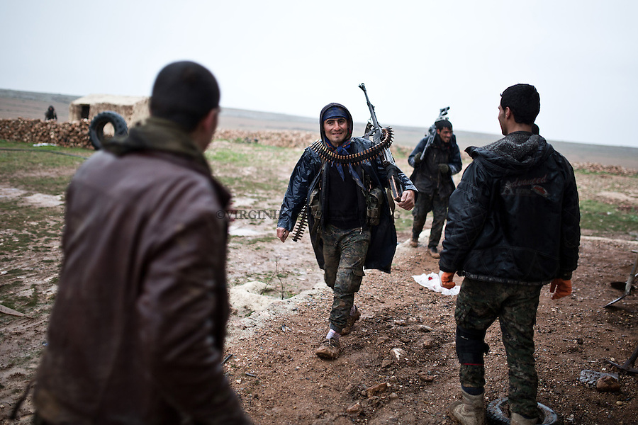SYRIA: YPG fighters returning from the front line of the cement plant 6km from the city of Tal Abyad.<br />