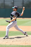 Stephen Kahn #9 of the Seattle Mariners plays in an extended spring training game against the Cleveland Indians at the Indians minor league complex on May 14, 2011  in Goodyear, Arizona. .Photo by:  Bill Mitchell/Four Seam Images.