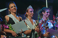 Eva Molnar (L) placed third, Barbara Palmaffy (C) winner and Ilka Bardoczy (R) placed second celebrate their victory during the Miss Poledance Hungary 2011 competition in Budapest, Hungary on September 04, 2011. ATTILA VOLGYI