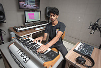 Profile portrait of Anoop D'Souza '19.<br /> From Oklahoma City to the urban lights of Los Angeles, music production major Anoop D'Souza '19 is creating a foundation for a burgeoning music career through a liberal arts education.<br /> As a working music producer, D'Souza knows what it takes to break into the industry. His experience as an artist and a student is helping Occidental's music department shape its new production track, while providing him with a space to learn, create and collaborate with peers and faculty.<br /> Photo taken June 6, 2018 in Booth Hall. <br /> (Photo by Marc Campos, Occidental College Photographer)