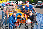 Checking everthing at the start of the 32nd rally of the Lakes in Killarney last Saturday were(front) driver and navigator Edward Giggins and Shane McCarthy,kilgarvan(back)L-R Diarmuid Cremins,Tralee,and Johnny Fitzgerald and Neill Riordan,Kenmare.