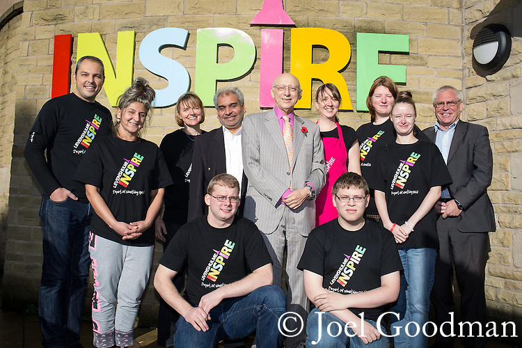 © Joel Goodman - 07973 332324 . 2 November 2013 . Levenshulme Inspire , Stockport Road , Manchester , UK . Back L-R: Ed Cox (chairman) , Jarmila Jarsonova (cleaner) , Jane Graystone (manager) , Cllr Aftab Ahmed , Sir Gerald Kaufman MP , Susannah Townsend (cafe manager) , Beth Marshall (development manager) , Cassie Brown (cleaner) , Cllr Bernard Stone ; Front L-R Colin Raggett (volunteer) and Paul Belfield (services officer) (all correct). Centre workers and local politicians . The Levenshulme Inspire Community Centre celebrates its 3rd birthday and being awarded a 3-year lottery grant to enable the provision of new services for older residents . Photo credit : Joel Goodman
