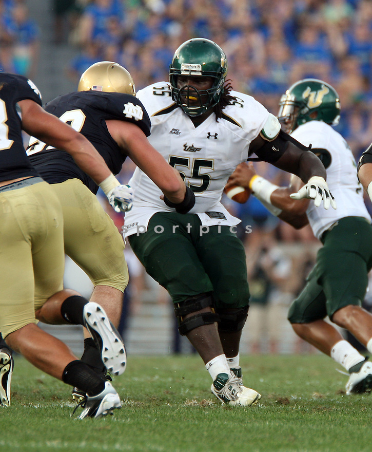 JEREMIAH WARREN, of South Florida, in action during South Florida's game against the University of Notre Dame on September 3, 2011 at Notre Dame Stadium in South Bend, Indiana. South Florida beat Notre Dame 23-20.