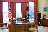 United States President Barack Obama talks with House Speaker John Boehner by phone from the Oval Office, April 8, 2011..Mandatory Credit: Pete Souza - White House via CNP