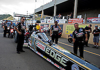 Jul. 19, 2013; Morrison, CO, USA: NHRA crew members for top fuel dragster driver Brittany Force during qualifying for the Mile High Nationals at Bandimere Speedway. Mandatory Credit: Mark J. Rebilas-