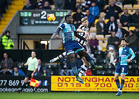 Aaron Pierre of Wycombe Wanderers & Jonathan Stead of Notts Co go for the ball during the Sky Bet League 2 match between Notts County and Wycombe Wanderers at Meadow Lane, Nottingham, England on 10 December 2016. Photo by Andy Rowland.
