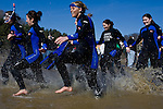 "Kristin Todd, left, leads her club soccer team into the freezing cold water during the ""Freezing for a Reason: Polar Bear Plunge"" at Dow Lake on Saturday, February 16, 2008 in Athens, Ohio.  photo by Kevin Riddell"