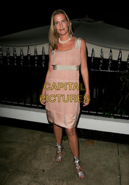 INDIA HICKS.Leaving her Launch Party for Crabtree & Evelyn.at The Hempel Hotel, London, England, .November 22nd 2006..full length pink gold silk satin dress waistband strappy silver shoes sandals.CAP/AH.©Adam Houghton/Capital Pictures