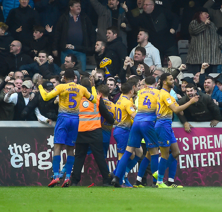 Mansfield Town's Jacob Mellis celebrates scoring his side's equalising goal with team-mates to make the score 1-1<br /> <br /> Photographer Andrew Vaughan/CameraSport<br /> <br /> The EFL Sky Bet League Two - Lincoln City v Mansfield Town - Saturday 24th November 2018 - Sincil Bank - Lincoln<br /> <br /> World Copyright © 2018 CameraSport. All rights reserved. 43 Linden Ave. Countesthorpe. Leicester. England. LE8 5PG - Tel: +44 (0) 116 277 4147 - admin@camerasport.com - www.camerasport.com