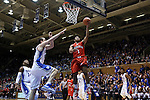 15 November 2014: Fairfield's Jerome Segura (1) has a shot blocked by Duke's Marshall Plumlee (left). The Duke University Blue Devils hosted the Fairfield University Stags at Cameron Indoor Stadium in Durham, North Carolina in an NCAA Men's Basketball exhibition game. Duke won the game 109-59.