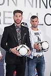 Real Madrid´s players Sergio Ramos and Jese attend the `Ningun nino sin regalo´ campaign in Madrid, Spain. January 05, 2015. (ALTERPHOTOS/Victor Blanco)