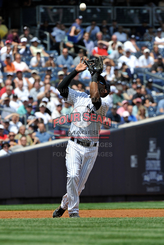 New York Yankees infielder Eduardo Nunez #26 during a game against the Texas Rangers at Yankee Stadium on June 16, 2011 in Bronx, NY.  Yankees defeated Rangers 3-2.  Tomasso DeRosa/Four Seam Images