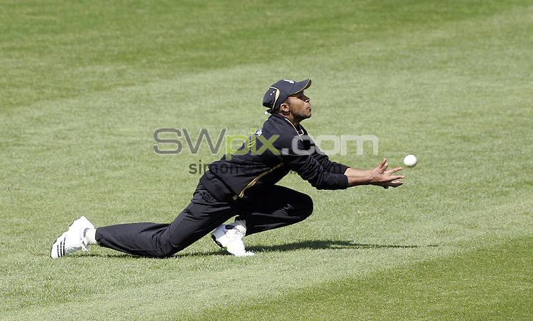 PICTURE BY VAUGHN RIDLEY/SWPIX.COM - Cricket - Friends Provident Trophy - Yorkshire v Gloucestershire - Headingley, Leeds, England - 03/05/09...Copyright - Simon Wilkinson - 07811267706...Yorkshire's Adil Rashid catches Gloucestershire's Chris Taylor out off the bowling of Deon Kruis.