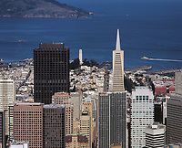 aerial photograph of the TransAmerica pyramid, the Bank of America tower and Coit Tower with San Francisco Bay and Angel Island in the background