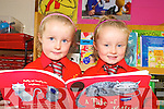 Twins Chelsea and Ella McCarthy settle into the books during their first day in Holy Cross Mercy school in Killarney on Monday.   Copyright Kerry's Eye 2008