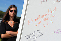 9/11/12 10:37:24 AM - Lower Makefield, PA.. -- A woman views sentiments on the Wall of Remembrance after a memorial service at the Garden of Reflection September 11, 2012 in Lower Makefield, Pennsylvania. The Garden of Reflection 9-11 Memorial was created to remember and honor the 2,973 killed on September 11, 2001. 18 of the victims were residents of Bucks County, Pennsylvania. -- (Photo by William Thomas Cain/Cain Images)