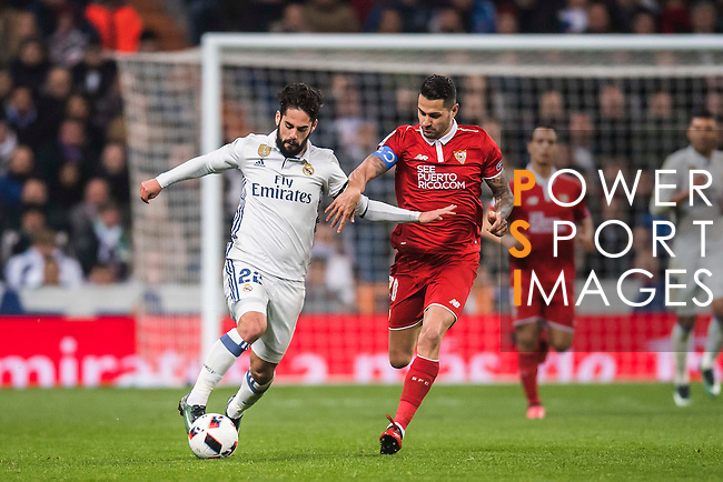 "Isco (l) of Real Madrid fights for the ball with Victor Machin Perez ""Vitolo"" of Sevilla FC during their Copa del Rey Round of 16 match between Real Madrid and Sevilla FC at the Santiago Bernabeu Stadium on 04 January 2017 in Madrid, Spain. Photo by Diego Gonzalez Souto / Power Sport Images"