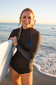 Stock photo woman with surfboard at the beach