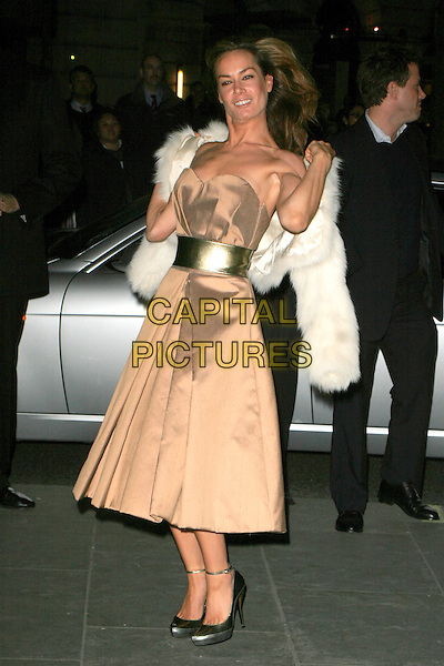 """TARA PALMER TOMKINSON.VIP private view of """"Vanity Fair Portraits"""" sponsored by Burberry, National Portrait Gallery, London, England..February 11th, 2008.full length gold belt beige brown dress white fur jacket black clutch bag purse .CAP/AH.©Adam Houghton/Capital Pictures."""