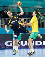 Spain's Albert Rocas (l) and Australia's Caleb Gahan during 23rd Men's Handball World Championship preliminary round match.January 15,2013. (ALTERPHOTOS/Acero) /NortePhoto